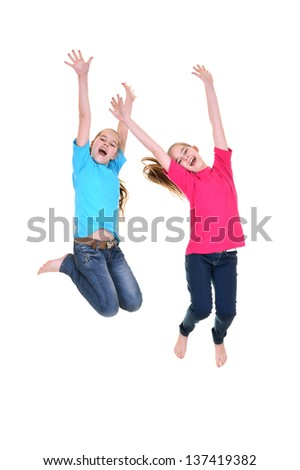 happy young girl in colored T-shirts jumping on a white background
