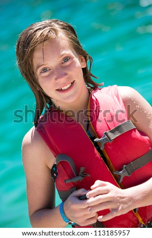 Happy young girl in life vest