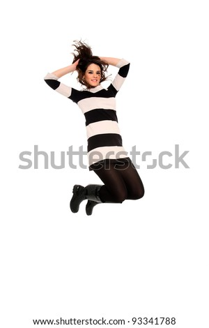 happy young girl jumping isolated on a white background - stock photo