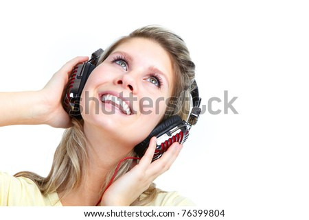 Happy young girl listening to the music #76399804