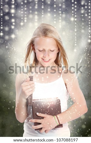 Happy Young Girl Opening a Gift Box