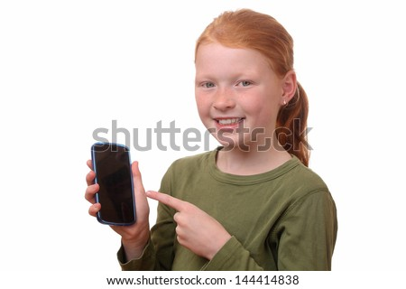 Happy young girl shows her new smartphone - stock photo