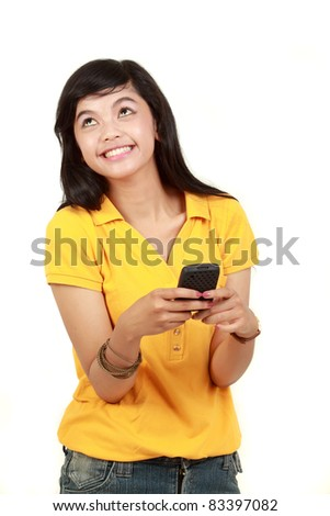 Happy young girl text message on her mobile phone