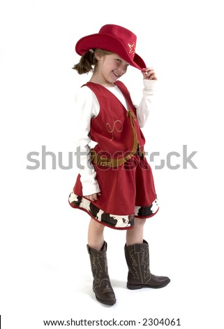 Happy young girl with a cowboy hat  and cowboy boots