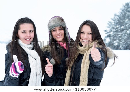 happy young girls are having fun in the snow