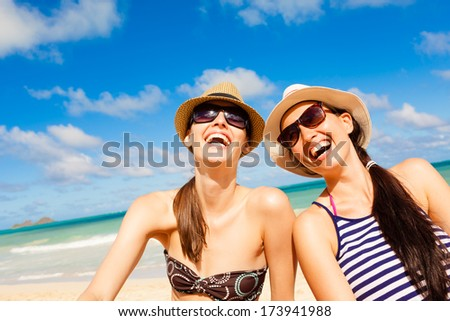 Happy young girls having fun on the beach.
