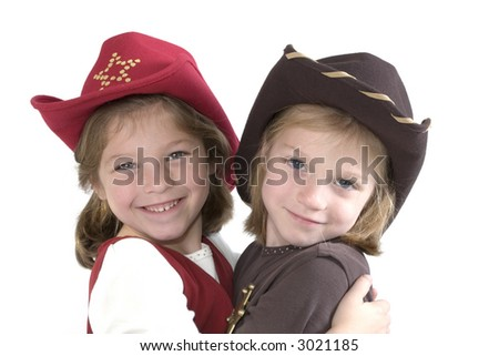 Happy young girls with a cowboy hat