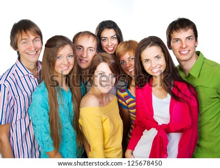 Happy young group of people standing together over white