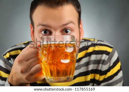happy young guy drinking beer