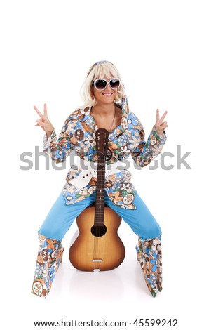happy young hippie woman holding a guitar (isolated on white)