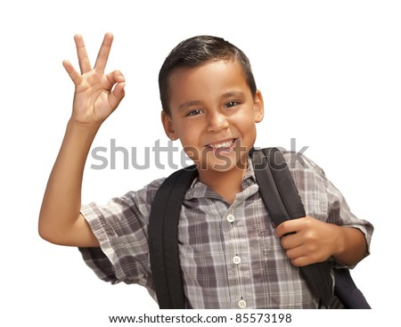 Happy Young Hispanic Boy Giving an Okay Hand Sign with Backpack Ready for School Isolated on a White Background.