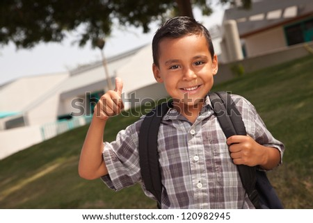 Happy Young Hispanic School Boy with Thumbs Up one Morning.