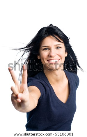 Happy young latin teenager girl showing victory sign isolated on white background