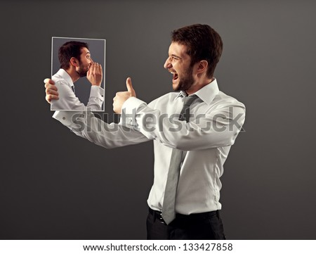 happy young man agree with his inner voice - stock photo