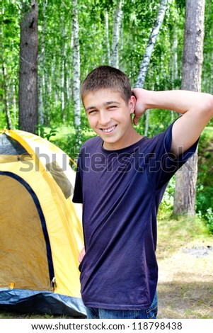 Happy young Man camping in the forest