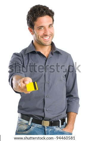 Happy young man giving credit card ready for the payment, isolated on white background