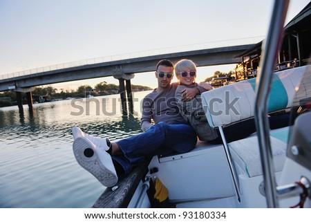 happy young man have fun at boat at sunset on summer season