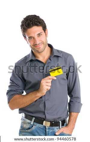 Happy young man holding credit card on heart isolated on white background