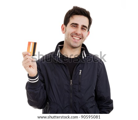 Happy young man holding credit card on white