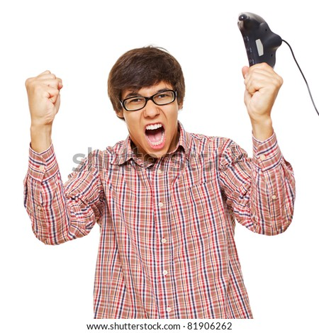 Happy young man in winning pose in glasses wearing shirt holding video game joystick over isolated background. Mask included