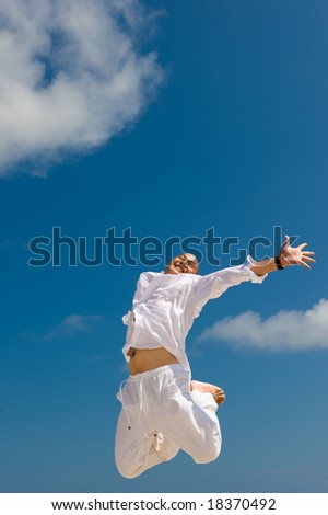 happy young man jumping with excitement