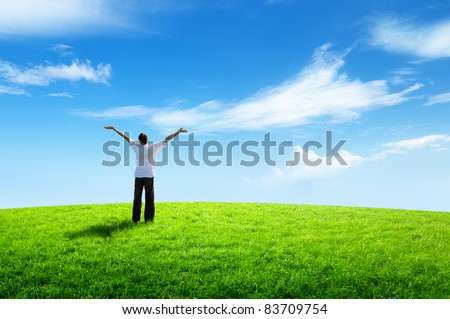 happy young man on green field