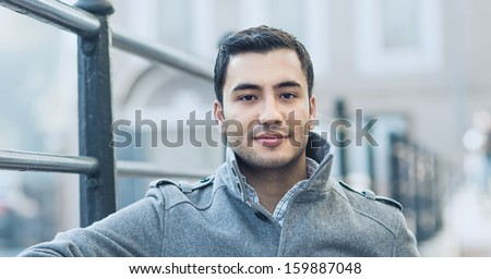 Happy young man, outdoor - outside. Close up of gorgeous male in coat, coldly morning