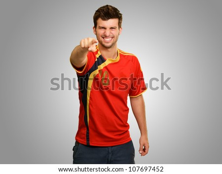 Happy Young Man Pointing Isolated On Gray Background