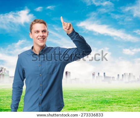happy young-man pointing up