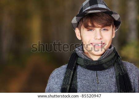 Happy young man posing outdoor.