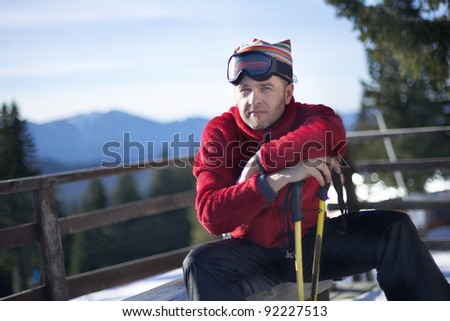 happy young man relaxing at snow with ski on fresh air