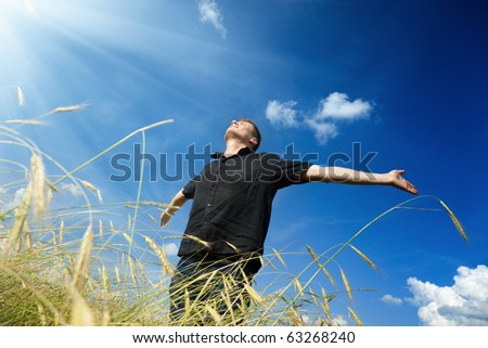happy young man rest on wheat field - stock photo