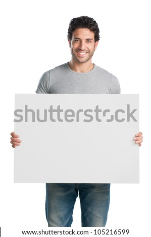 Happy young man showing and displaying placard ready for your text or product Stock photo ©