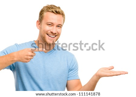Happy young man showing empty copy space on white background
