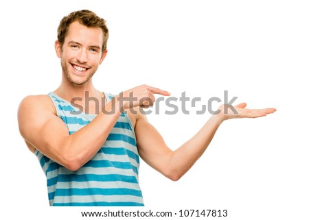 Happy young man showing empty copyspace on white background