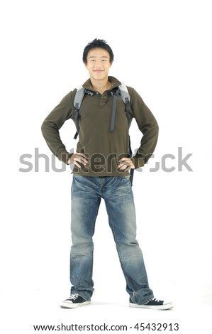 Happy young man standing with book and bag