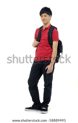 Happy young man standing with book and bag,