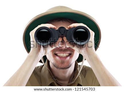 Happy young man wearing safari shirt and pith helmet looking through binoculars, isolated on white, close-up #121545703