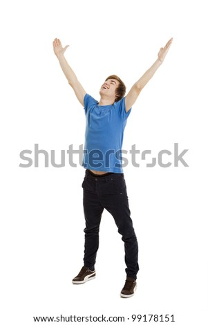 Happy young man with arms raised in the air, isolated on white background