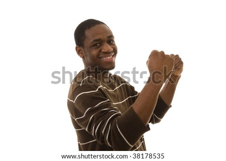 Happy young man with his arm up celebrating something