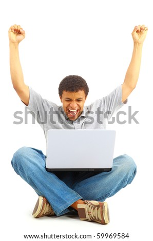 Happy young man working on a laptop, isolated against white background