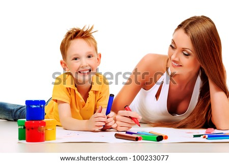 Happy young mother and her son having fun together. Isolated over white.