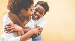 Happy young mother having fun with her kid - Son hugging his mum outdoor - Family connection, motherhood, love and tender moments concept - Focus on woman eye