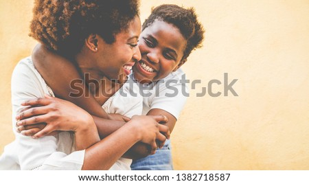 Happy young mother having fun with her kid - Son hugging his mum outdoor - Family connection, motherhood, love and tender moments concept - Focus on woman eye #1382718587