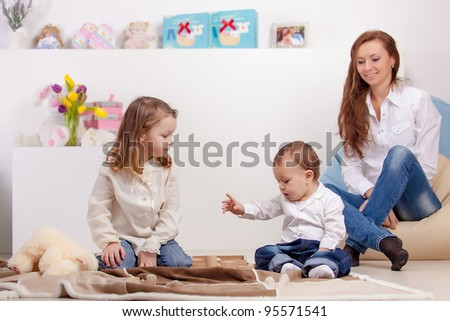 Happy young mother looking for playing children