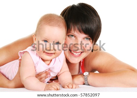 Happy young mother with her five months old baby girl with blue eyes smiling