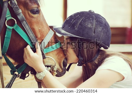 Happy young people on countryside with horse for riding