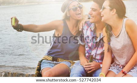 Happy young people taking selfies and having fun #527742034
