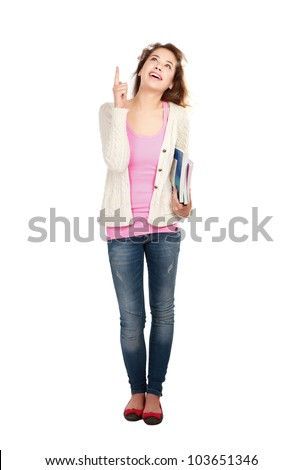 Happy young positive student pointing something interesting .Isolated on white background