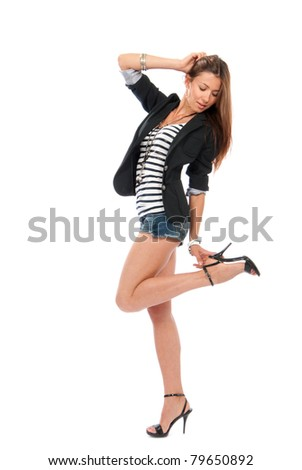 Happy young pretty full body brunette woman dancing in casual cloth with touching hill isolated on a white background